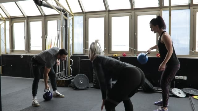 Ladies exercising with fitness trainer