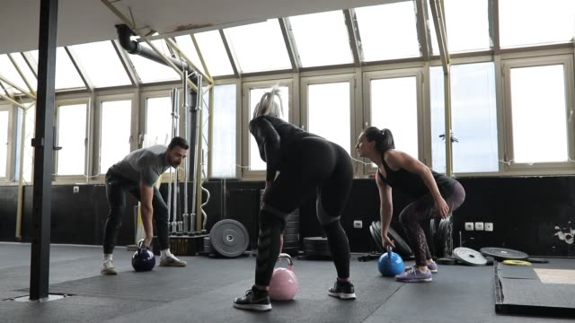 Ladies exercising with personal trainer
