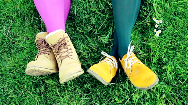 ladies' feet in vivid shoes against green grass - shoes fashion stock videos and b-roll footage