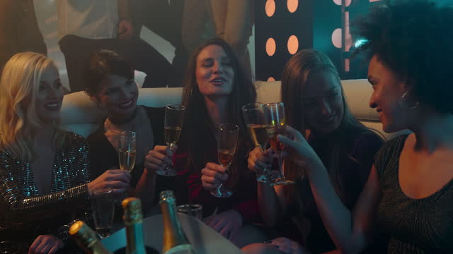 Ladies making a toast with champagne on a party