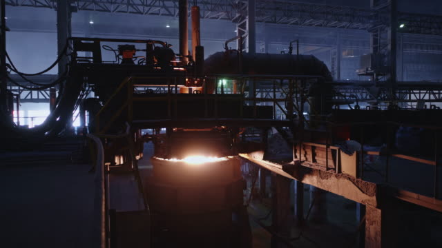 Ladle Refining Furnace at a Large Steel Factory Steel, Factory, Business, Industry, Africa - LRF, Also Known as Ladle Refining Furnace is in use to raise the temperature adjusting the chemical composition of molten metal to produce high quality steel foundry stock videos & royalty-free footage