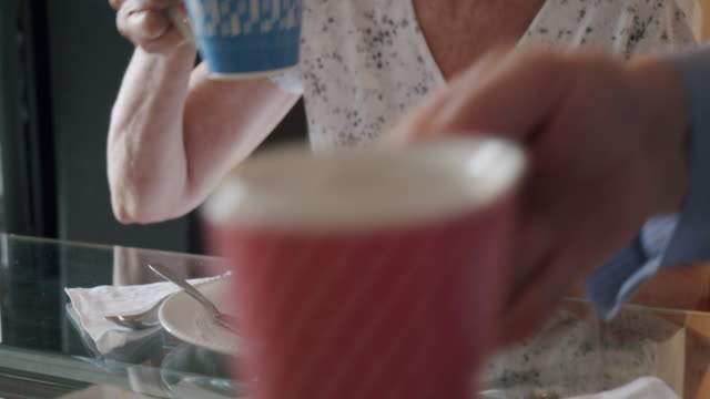 lady doing breakfast with her husband at home - 60 69 anni video stock e b–roll