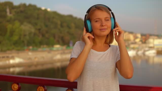 lady enjoys music in her headphones - portraite woman video stock e b–roll