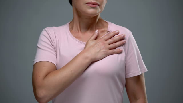 vídeos de stock e filmes b-roll de lady feeling pain in heart, tachycardia, prevention of stroke and heart attack - coração fraco