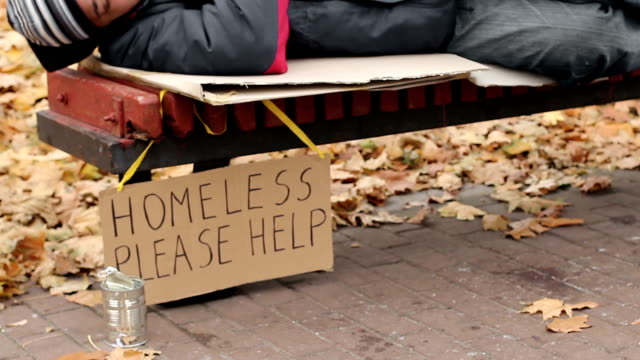 Lady helping poor homeless man by throwing dollars in can, charity, poverty video