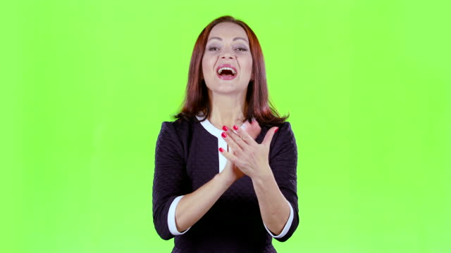 Lady in the theater claps bravely to the actors. Green screen video
