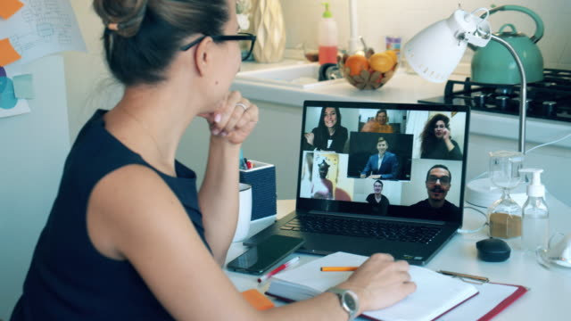 A lady is greeting her colleagues during a video conference call. Meeting online, remote work using videocall. video