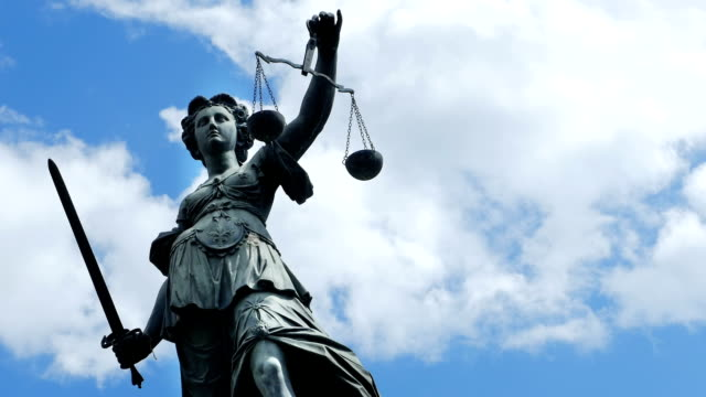 Lady Justice Against Cloudy Sky (4K/UHD to HD) Figure of Lady Justice against blue sky. 4K/Ultra-HD ProRes 422 (HQ) downconverted to HD.  law stock videos & royalty-free footage
