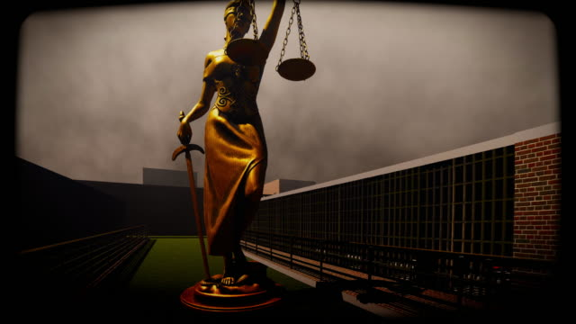 Lady justice standing at prison yard