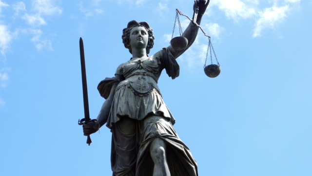 Lady Justice With Scales And Sword Real time shot made in 4K/Ultra High Definition. statue stock videos & royalty-free footage
