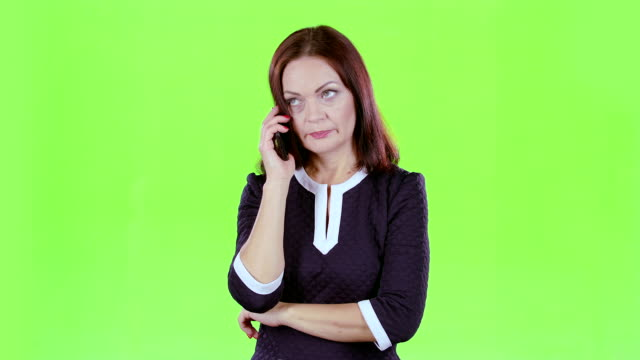 Lady scolded the phone with her boyfriend. Green screen video
