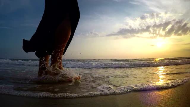 Lady walking along seacoast