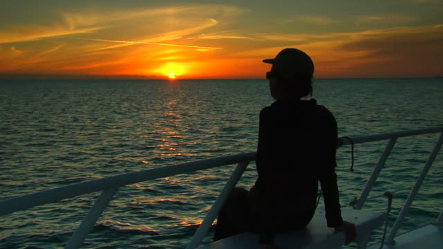 Lady watching the sunset video