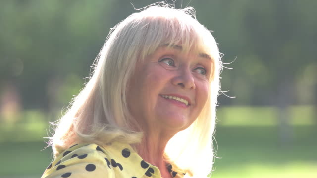 Lady with gray hair smiles. video