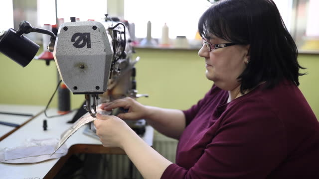 Lady working on sewing machine video