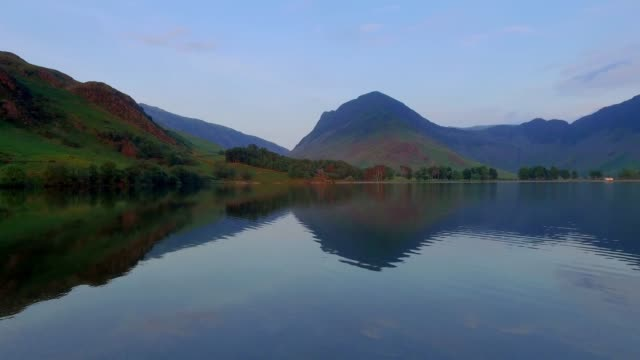 Lake and mountains at sunset in calm day in the Lake District, England