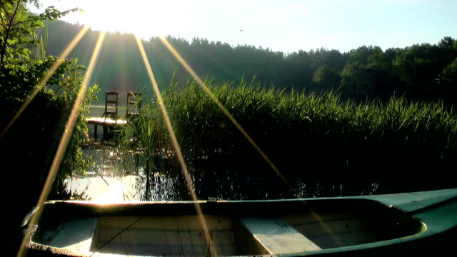 Lake at sunrise, boat, Masuria lake district video