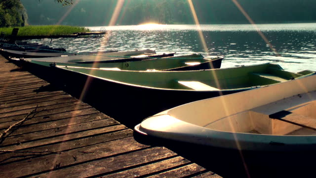 Lake at sunrise, boats, Masuria lake district video