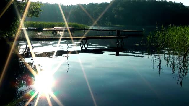 Lake at sunrise, bridge, Masuria lake district video