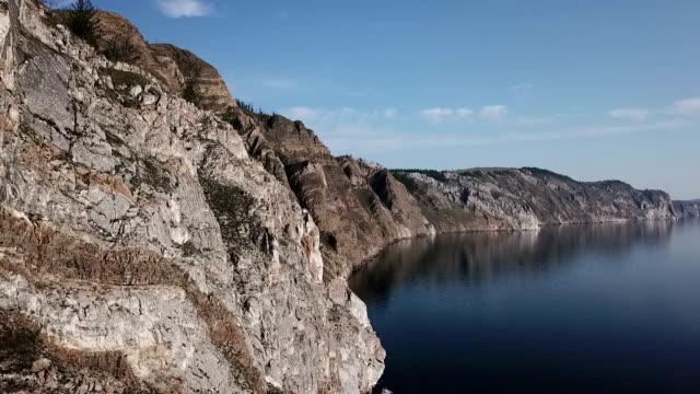 vídeos de stock e filmes b-roll de lake baikal. olkhon island. aerial survey. scenic lake snow field mountain in summer. sunny day. - lago baikal