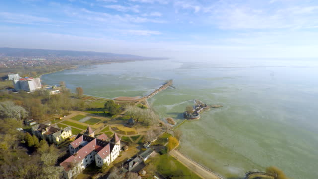 AERIAL Lake Balaton Aerial shot of the largest lake in Central Europe. Lake Balaton is a freshwater lake in the Transdanubian region of Hungary. Wide view over the lake at sunset. Hungary. Europe. hungary stock videos & royalty-free footage