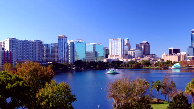 Lake Eola Down Town Orlando Florida With Trees Aerial Wide Going UP video