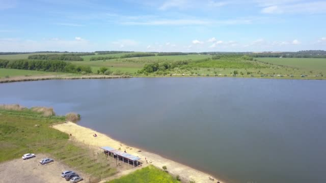 lake for recreation and fishing from a bird's eye view - quadcopter filmów i materiałów b-roll