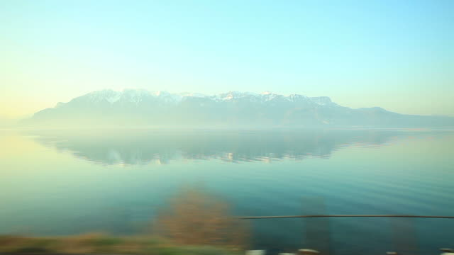lake geneva and sunset of alps - train stock videos and b-roll footage