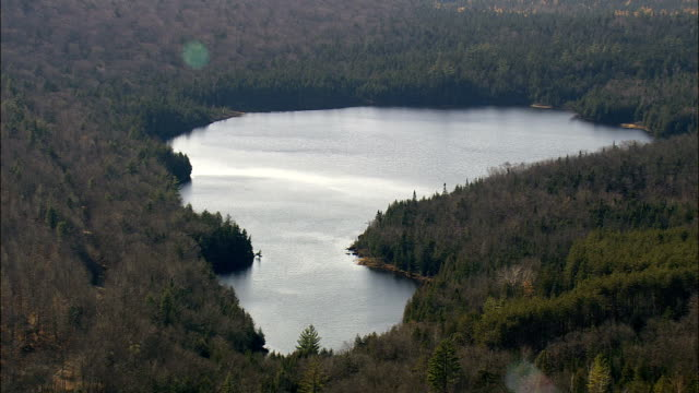 lake in Adirondack mountains - Aerial View - New York,  Essex County,  United States video
