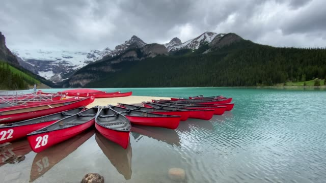 Lake Louise Panorama and canoes in the Morning, Alberta, Canada