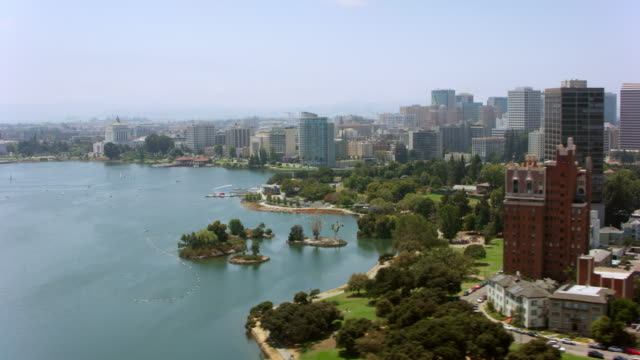 AERIAL Lake Merritt and Oakland center in California, USA Aerial shot of Lake Merritt in the center of Oakland California. Shot in USA. oakland stock videos & royalty-free footage