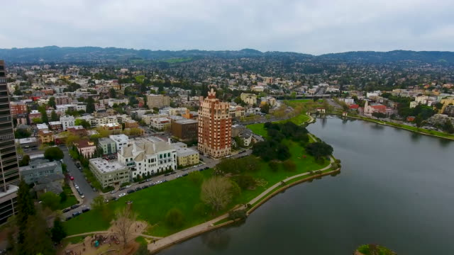Lake Merritt Fly Over Aerial view of Lake Merritt, including surrounding buildings and small islands in the lake. Birds can be seen flying over the lake. oakland stock videos & royalty-free footage