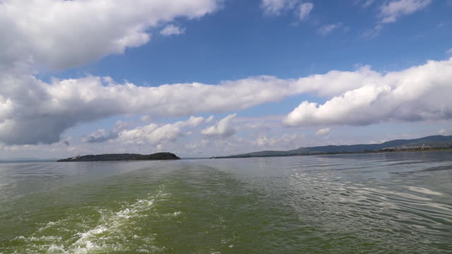 Lake navigation - ship wake - birds follow the ship