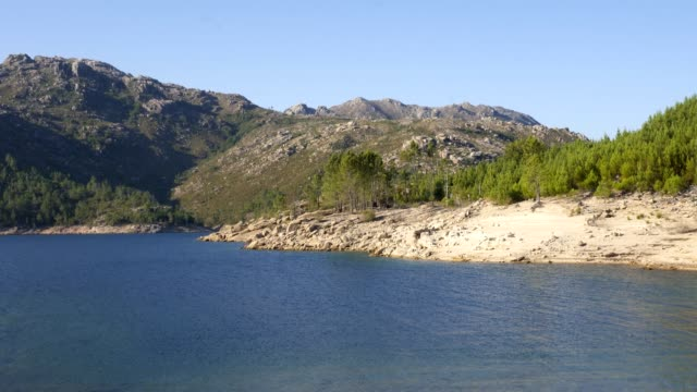 vídeos de stock e filmes b-roll de lake of dam in vilarinho da furna beautiful nature landscape in geres national park, in portugal - barragem portugal