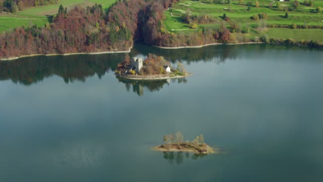 Lake of Gruyere in golden autumn video