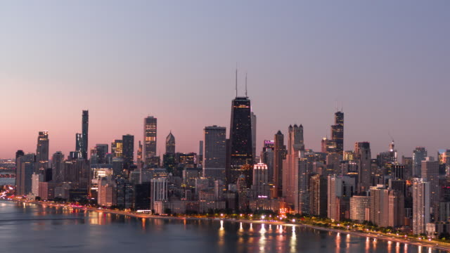 Lake Shore Drive at Dawn - Aerial Aerial View of Chicago Lake Shore Drive and North Avenue beach at Sunrise - October 2019 chicago stock videos & royalty-free footage