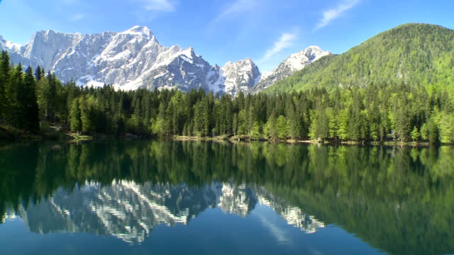 WS AERIAL Lake With Mountain In Background HD1080p: Wide angle aerial shot of a famous natural landmark lake Laghi di Fusine with Mt Mangart in the background. summer background stock videos & royalty-free footage