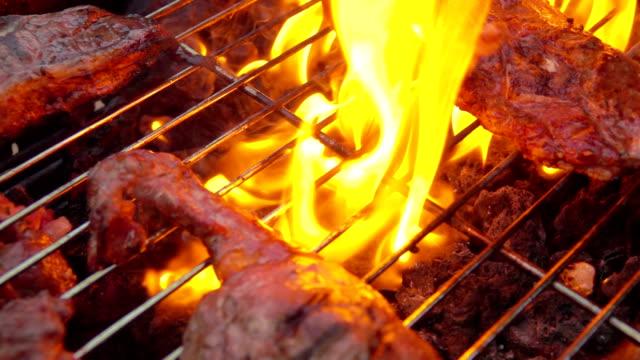 Lamb steak flipped on the grill video