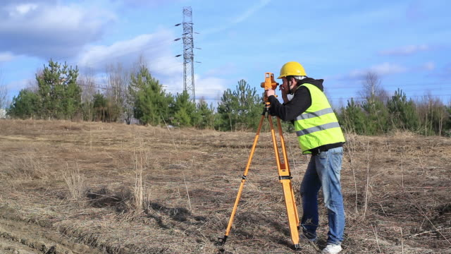 Land surveyor on construction site video