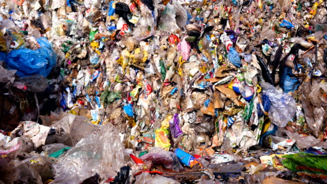 Landfill site, urban refuse dump. Lots of plastic, waste garbage collected in cubes. video