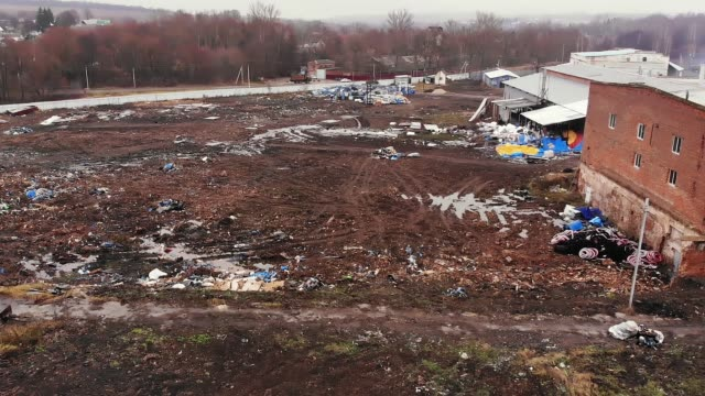 landfill site with garbage pile of human waste by houses video
