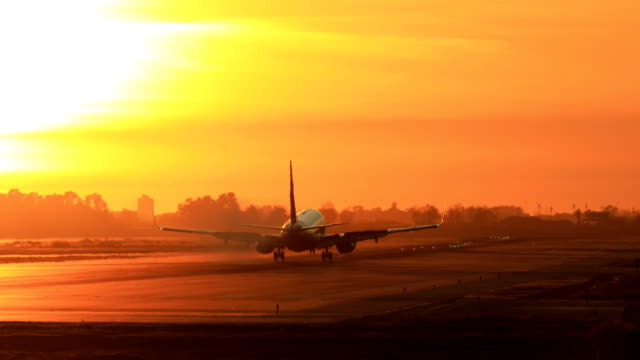 "Landing airplane during sunset - Barcelona ""El Prat Aeroport"" Airplane landing during sunset in Barcelona airport runway stock videos & royalty-free footage"