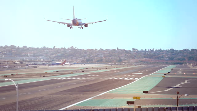 Landing airplane in California 4K Professional video of landing airplane in 4K landing touching down stock videos & royalty-free footage