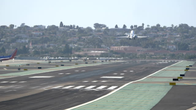 Landing airplane in California airport 4K video