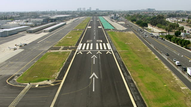 Landing on airport runway, aerial shot video