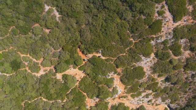 Landing To Green Ocean Cliff. High Angle Aerial View