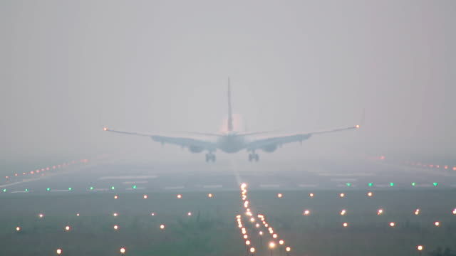 Landing. jet airplane landing, early morning  airfield stock videos & royalty-free footage