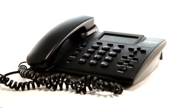 Landline phone rotating on white background Landline phone rotating on a white background cordless phone stock videos & royalty-free footage