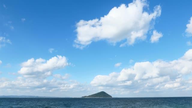 vídeos de stock e filmes b-roll de landscape of himejima island at fukuoka city - linha do horizonte sobre água