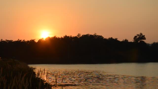 landscape of mountain on sunset in reservoir